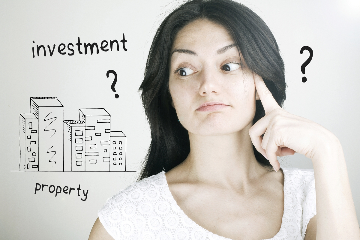 Lady with question marks to invest in property